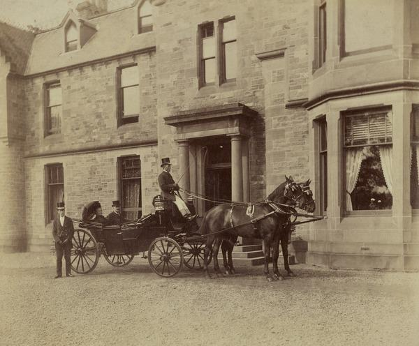 Provost and Lady Boyd in an open carriage before a house