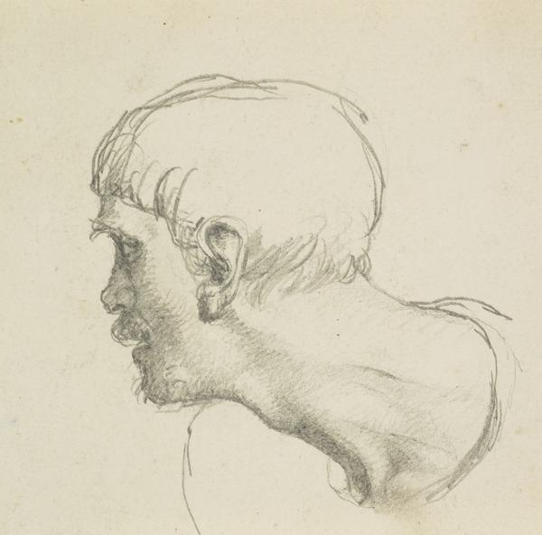 A man's head and shoulders, turning to his right