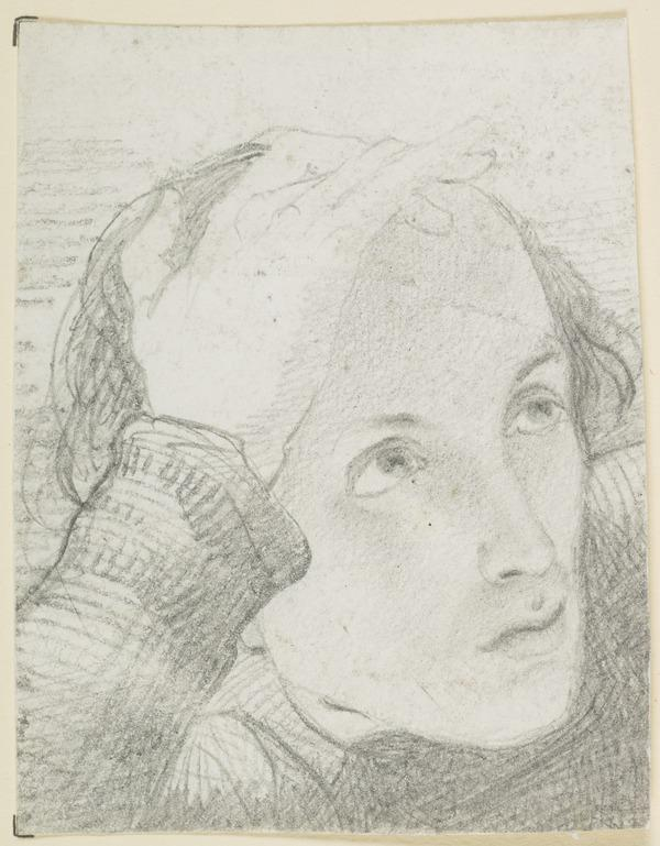 A woman's head resting on her hand
