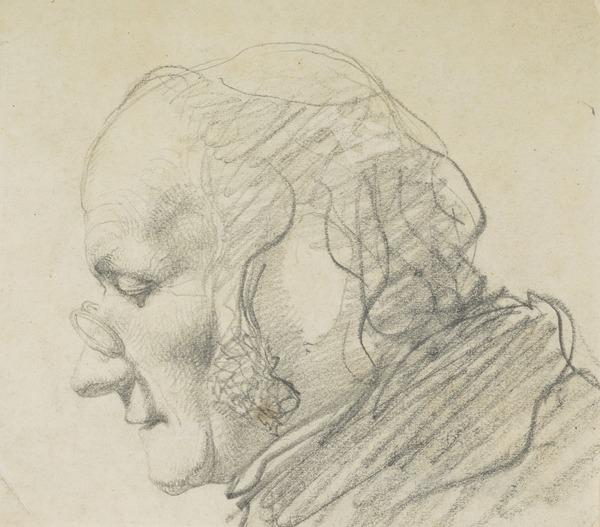 A man's head in profile, wearing spectacles