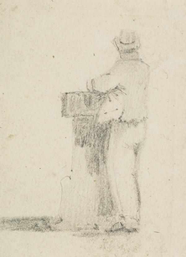 A man standing, leaning on a bollard