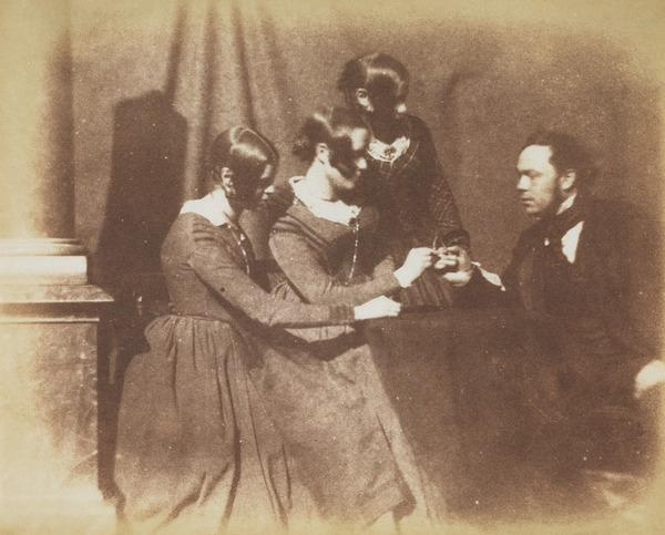 Three women and one man; the man and one of the women pulling a wishbone