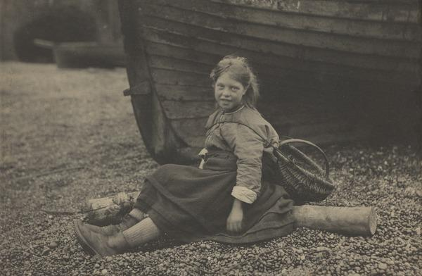 'At Auchmithie 1881'. Girl with basket sitting on shore in front of boat (1881)