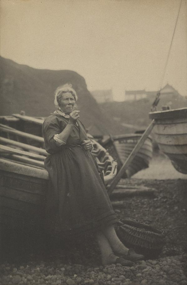 'At Auchmithie 1881'. Woman leaning against boat (1881)