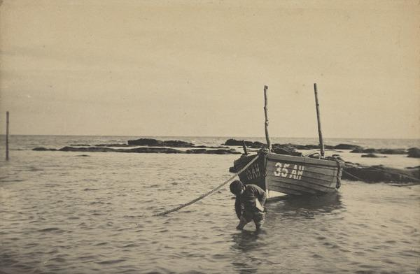 'At West Haven 1881'. Boy wading, boat moored behind him (1881)