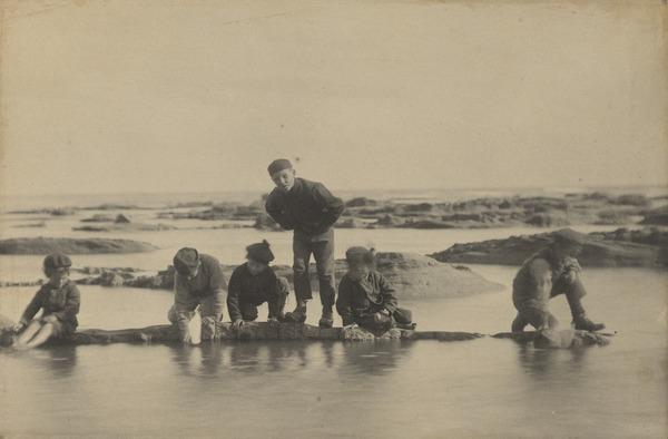 'At West Haven 1881'. Boys on submerged rocks, ?with toy sailing boats (1881 (changed from 1882))