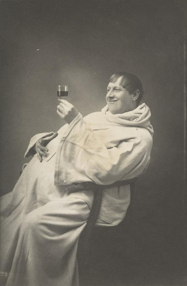 Monk with wine glass