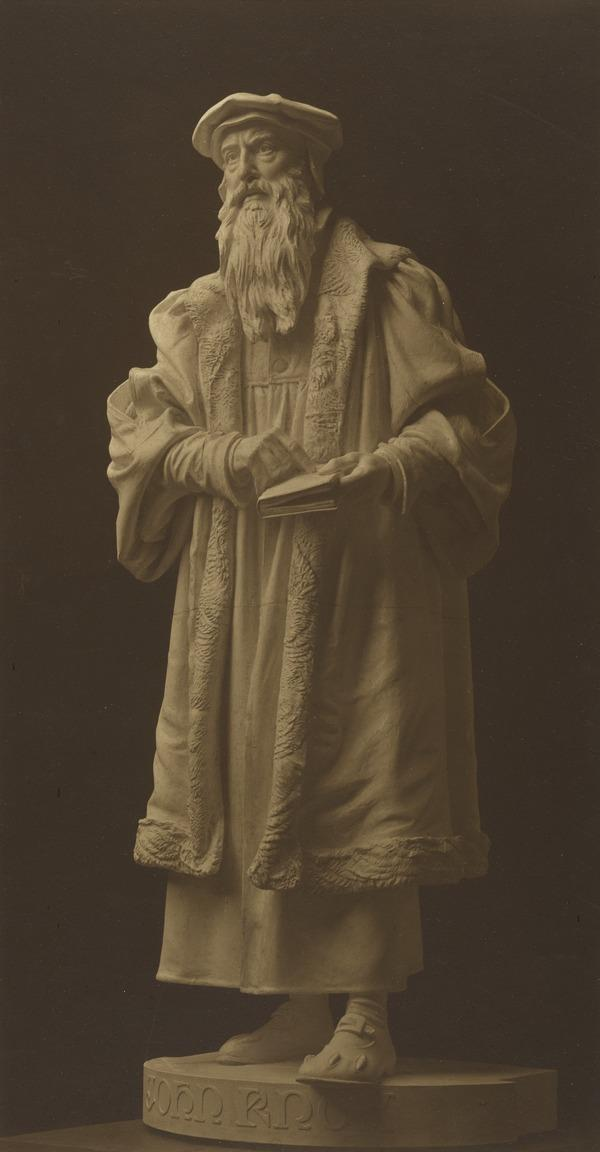Statue of John Knox with a Book
