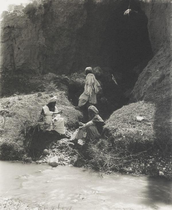3 men in gorge by river