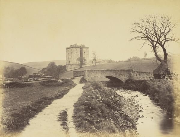 Borthwick Castle in landscape with stream, path and bridge, haystack and tree (About  1860s)