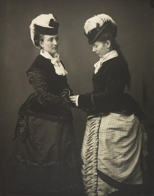 Two Women with Feathered Hats