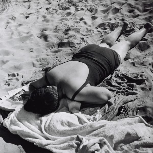 Untitled [Woman asleep on sand, Austria] (About 1930 (negative))