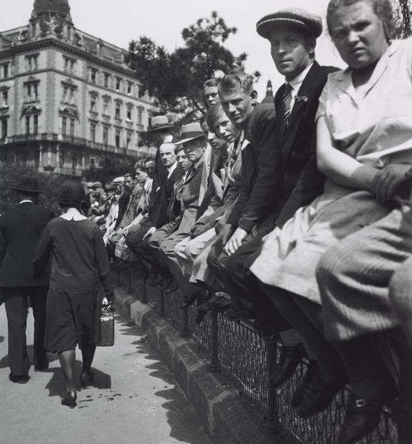 Untitled [People sitting on fence, Vienna] (About 1930)